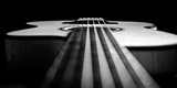 Close Up a Steel String Acoustic Guitar Built by Luthier John Slobod Stretched Canvas Print by Amy & Al White & Petteway