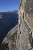 A climber walks a 40-foot-long sliver of granite on Half Dome, named the Thank God Ledge. Bedruckte aufgespannte Leinwand von Jimmy Chin