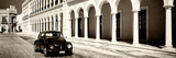 ¡Viva Mexico! Panoramic Collection - Black VW Beetle and Mexican Architecture Sepia Fotografie-Druck von Philippe Hugonnard